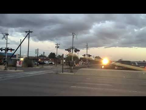 A Northbound BNSF #8424 Empty Energy Coal Train With Rain [Video]